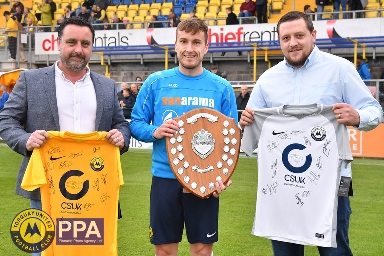 Luke Young is presented his Player of the Season Award by Neil Pardon & Kalern from shirt sponsor Custom Surfaces UK.